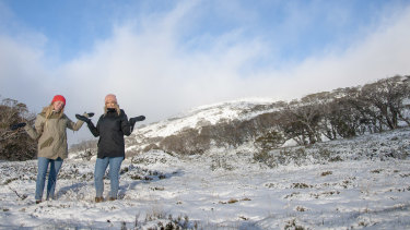 Chelsea Rae and Alandra Swain enjoy the first snowfall at Perisher for 2019.