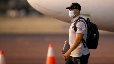 NZ Warriors captain Roger Tuivasa-Sheck walks across the tarmac after arriving in Tamworth as his club helped save the NRL season.