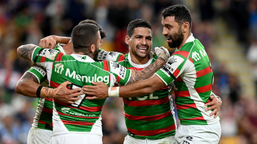 Cody Walker is congratulated by teammates after scoring at Suncorp Stadium.