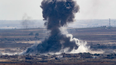 Smoke rising over the Syrian town of Ras al-Ain as Turkey presses on with its military campaign in Syrian territory.