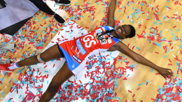 Sam Wallace celebrates the Swifts grand final triumph over the Lightning.