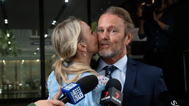 Craig McLachlan, pictured with his partner Vanessa Scammell, in December 2020.