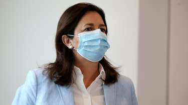 Queensland Premier Annastacia Palaszczuk arrives at her press conference in a face mask. Masks are compulsory in greater Brisbane this weekend.
