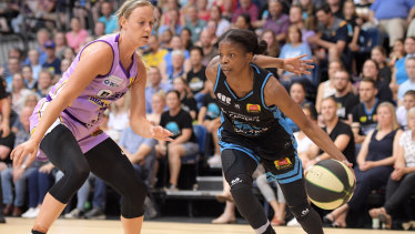 Frenchwoman Olivia Epoupa, right, put on a great performance to propel the Canberra Capitals into the WNBL grand final.