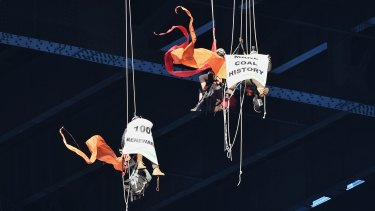 Greenpeace protesters hang off the Sydney Harbour Bridge on Tuesday morning.