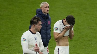 Disappointed England players leave the pitch after the draw with Scotland.