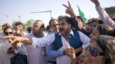 Supporters of former Pakistani prime minister Nawaz Sharif react outside the court following the ruling against him.
