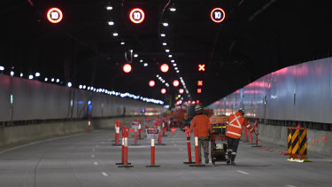 Construction workers in the almost-completed M4 East tunnels.