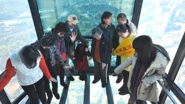 Tourists at the Eureka Skydeck in Melbourne.