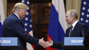 Donald Trump shakes hands with Vladimir Putin in Helsinki.