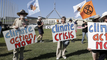Protesters rallied at Parliament House on Monday calling for more action on climate change.