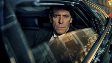 Hugh Laurie plays embattled politician Peter Laurence in the BBC1 drama Roadkill.