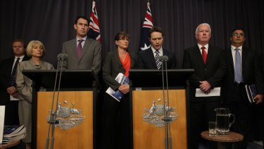 """Home Affairs Minister Jason Clare and Sports Minister Kate Lundy with sporting code representatives at the infamous """"blackest day"""" press conference in Canberra on February 7, 2013."""