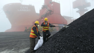 Chinese workers taking samples of imported coal at a port in Rizhao.