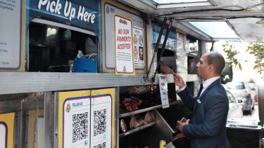 Vincent Morr orders lunch from a cashless food truck in San Francisco.