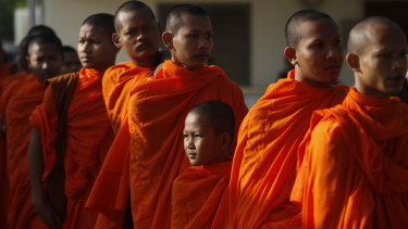 Cambodian Buddhist monks wait in queue to enter the courtroom before the hearings against two former Khmer Rouge senior leaders.