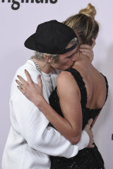 Bieber and Hayley Bieber get comfortable on the red carpet.