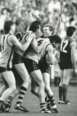 Gary Buckenara raises his arms in delight after kicking the winning goal after the siren against Melbourne.