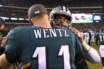 Carson Wentz and Dak Prescott hug after the Eagles beat the Cowboys.