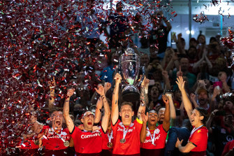 Adelaide United celebrate with the FFA Cup.