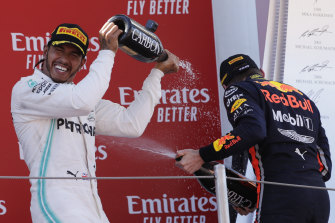 Lewis Hamilton, left, and Max Verstappen, right, on the podium at the 2019 Spanish Grand Prix.