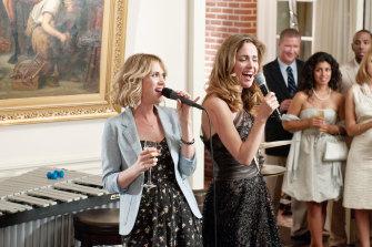 Byrne in Bridesmaids with Kristen Wiig.