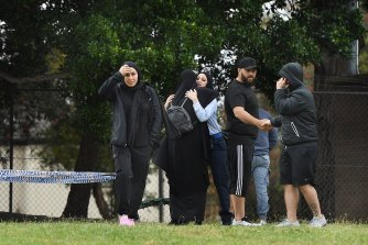 Family and friends gather near where Mejid Hamzy was shot dead.