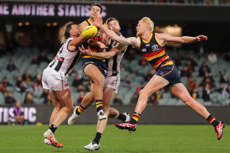 Collingwood's Jordan Roughhead (second right) was crunched in this collision.