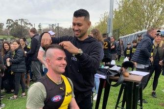 "Dusty Martin's barber Sakkarin Onnom giving Nick Greig a ""DMV""."