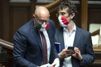 MPs Fabio Rampelli, left, and Galeazzo Bignami wear face masks in the colours of the Italian flag to protect themselves against the spread of COVID-19.