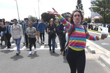 Hundreds of police swarm St Kilda to foil protests