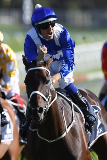 Celebration: Bowman has time to enjoy the moment as Winx canters past the post.