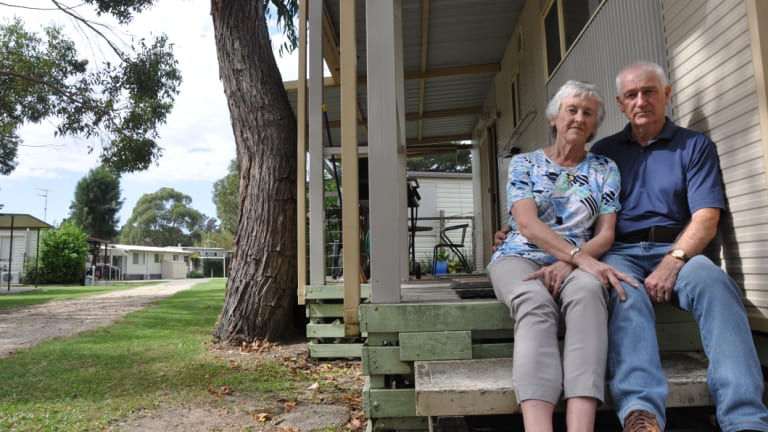 Canberra couple Elizabeth and Robin Turnbull outside their cabin, which they will soon be forced to remove from Tomaga River HolidayPark if a proposed redevelopment goes ahead.