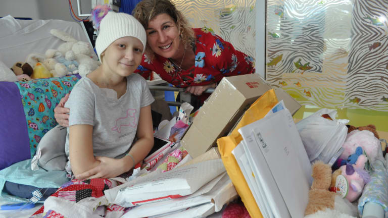 Tess Egginton with her mum Stephanie and the delivery of Warrior Mail at Perth Children's Hospital.