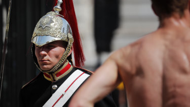 A member of the Queen's Lifeguard marches at Horse guards Parade as temperatures reached nearly 40 degrees in London.