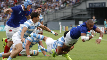 Heartbreak for Pumas: France's Gael Fickou dives across the line at Tokyo Stadium.
