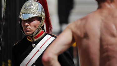 A member of the Queen's Lifeguard marches at Horse Guards Parade as temperatures rose far above 30 degrees in London.