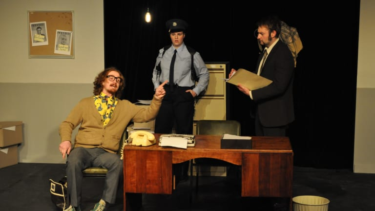 Hayden Splitt as Maniac, left, Anneka van der Velde as Constable and Nick Steain as Inspector Bertozzo in <i>Accidental Death of an Anarchist</i>.