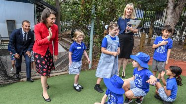 NSW Premier Gladys Berejiklian is seen with students from the Taverners Hill Infants School during a visit earlier this year.