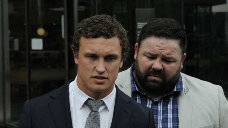 Canberra Raiders fullback Jack Wighton (left), supported by former NRL player George Rose apologises for his behaviour outside ACT courts on Wednesday.