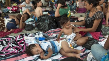 A group of migrants rests at the central park in Ciudad Hidalgo, Mexico, on Satuday.