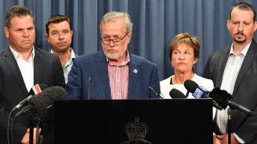 NSW Leader of the Shooters, Fishers and Farmers Party Robert Borsak (centre) speaks to the media on Friday.
