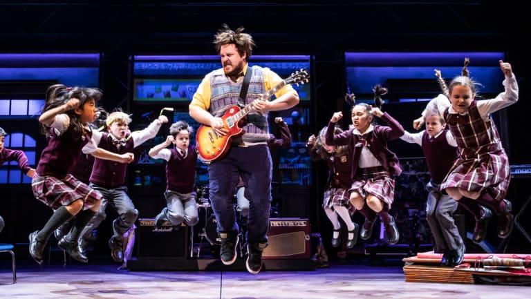 Dewey Finn (played by Brent Hill) rocks the class in Andrew Lloyd Webber's School of Rock.