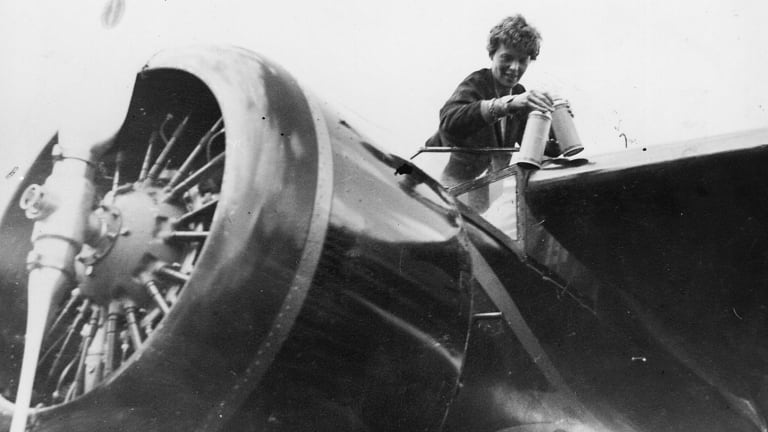 American aviator Amelia Earhart in the cockpit of her aeroplane at Culmore, near Derry, Ireland, after her solo Atlantic flight.