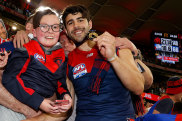 Christian Petracca celebrates with Melbourne fans.