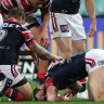 Cordner's pain for cousin compounded by head knock as Roosters run riot