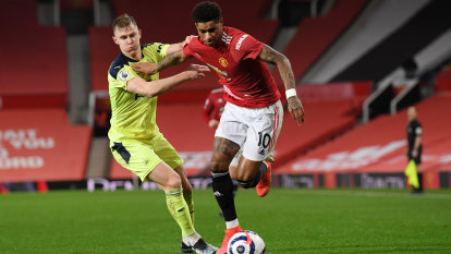 Rashford helps United to second spot as City record 18th straight win