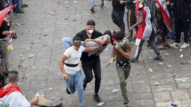 An injured protester is rushed to a hospital during a demonstration in Baghdad.