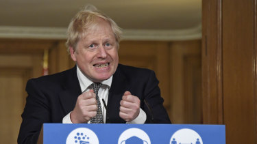Prime Minister Boris Johnson announces the lockdown during a Downing Street press conference.