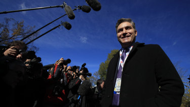 CNN's Jim Acosta speaks to journalist on the North Lawn upon returning to the White House on Friday.